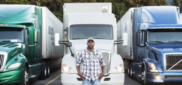 black-man-truck-driver-near-his-truck-parked-in-a--FD6XPWU (1)